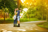 Affectionate couple on rollerblades — Photo