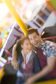 Happy couple enjoy in riding ferris wheel — Stock Photo