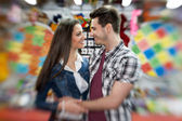Affectionate couple inattractions park — Stock Photo