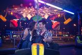 Affectionate couple in amusement park — Stock Photo