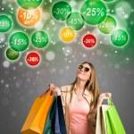 Shopping woman looking at discounts — Stock Photo