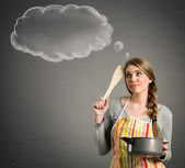 Housewife thinking what to cook — Stock Photo