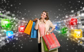 Shopping woman surrounded by icons of e-commerce — Stock Photo