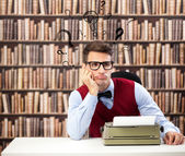 Old fashioned writer with question marks over head — Stock Photo