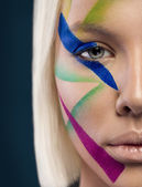 Girl with beautiful multicolor make-up — Stock Photo
