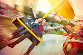 Young happy couple having fun at amusement park — Stock Photo
