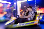 Couple ride bumper car — Stock Photo