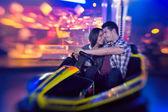 Couple in bumper car — Stock Photo