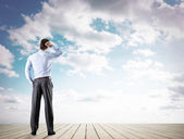 Businessman looking at sky — Stock Photo