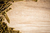 Wooden background with screw — Stock Photo