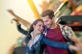 Couple enjoy in riding ferris wheel — Stock Photo