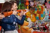 Couple playing shooting games — Stock Photo