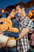 Affectionate couple at amusement park — Stock Photo