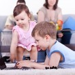 Boy and baby girl playing computer — Stock Photo #5514302