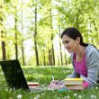 Young woman studying in the park — Stock Photo #5720463