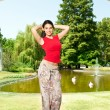 Beautiful young woman in park — Stock Photo #6458247