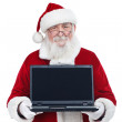 Santa Claus holding modern laptop, copy space, isolated on white — Stock Photo #7932541