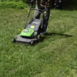 Stock Video: Mowing lawn