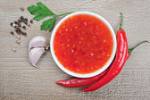 Red hot chilli sauce — Stock Photo