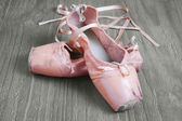 Old pink ballet shoes — Photo