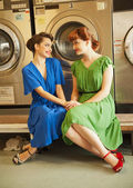Sisters in laundry — Stock Photo
