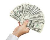 Hand with money — Stock Photo
