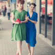 Urban scene with young women — Stock Photo #40261471