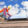 Worker and solar panels — Stock Photo #51313347