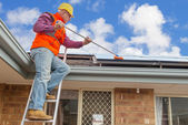 Worker and solar panels — Stock Photo