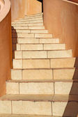 Winding beige stone staircase — Stock Photo