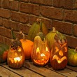 Stock Photo: Squashes and carved eggplants at halloween