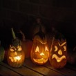 Squashes and carved eggplant lanterns at halloween — Stock Photo #12873800