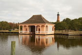 Historic boathouse and Currituck Beach Lighthouse near Corolla, — Stock Photo