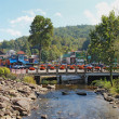 Foto de Stock  : Bridge over the Little Pigeon River in Gatlinburg, Tennessee