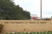 Sign for the University of Texas at Austin and stadium — Stock Photo