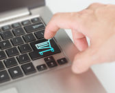 Push laptop shopping cart button online dealing and shopping con — Stock Photo
