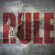 "Dirty and old cracked concrete wall with word ""RULE"" on it close — Stock Photo"