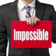 "Businessman use one hand to hold a red board with word ""Impossib — Stockfoto"
