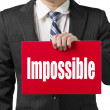 "Businessman use one hand to hold a red board with word ""Impossib — Стоковая фотография"