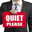 "Businessman use one hand to hold a red board with words ""QUIET P — Stockfoto"