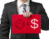 "Businessman use one hand to hold a red board with drawing ""time is money"" concept, close up in white background — Stock Photo"