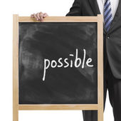 "Businessman hold dirty wooden chalk board with word ""impossible"" — Stock Photo"