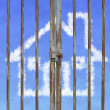 Locked door with cloud house in blue sky background — Stock Photo