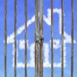 Locked door with cloud house in blue sky background — Stockfoto