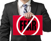 "Businessman use one hand to hold a red board with ""No Fear"" conc — Stock Photo"