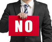 "Businessman use one hand to hold a red board with word ""No"" clos — Stock Photo"