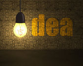 Glowing lamp with money symbol and idea word on bricks wall in d — Stock Photo