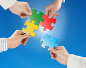 Team work concept, Hands hold puzzles with clear blue sky and su — Stock Photo