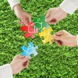 Hands hold puzzles with recycle symbol in fresh meadow backgroun — Foto Stock #35579821