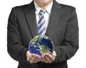 Businessman hold ball with global map — Stock Photo